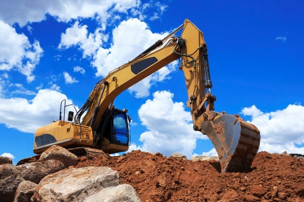 An excavator being used for land grading