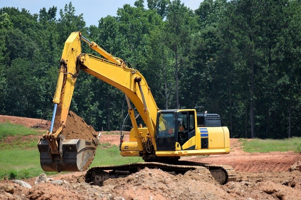 construction excavation being performed with heavy equipment.